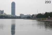 Photo of old and modern buildings of Yekaterinburg. The view to the City pond, skyscrapers Vysotsky (in the center) and Antey (on